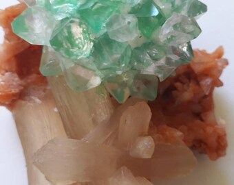 Green apophyllite with Stilbite on Orange Heulandite. Room assembled by man, non-natural formation.