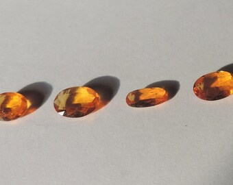 Clinohumite, set of four oval gems 2 cts. Rare and very clean precious stone. Port offered. #CL42