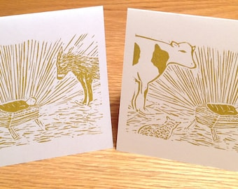 Baby Jesus in manger with animals linocut block print Christmas card