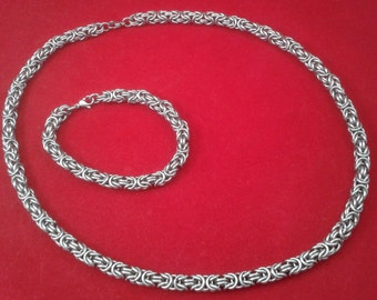 Matching set.  Solid stainless steel byzantine chainmaille bracelet and necklace.  Gift boxed.