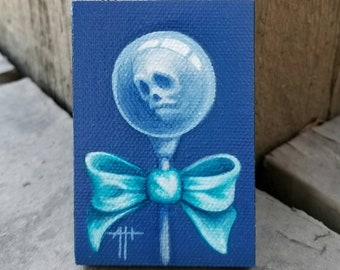 Blue Skull Pop original painting by Angel Hawari, haunted candy, lost soul, contemplation