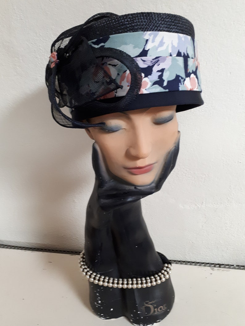 Navy straw pillbox hat size 56 straw and  floral embellishment