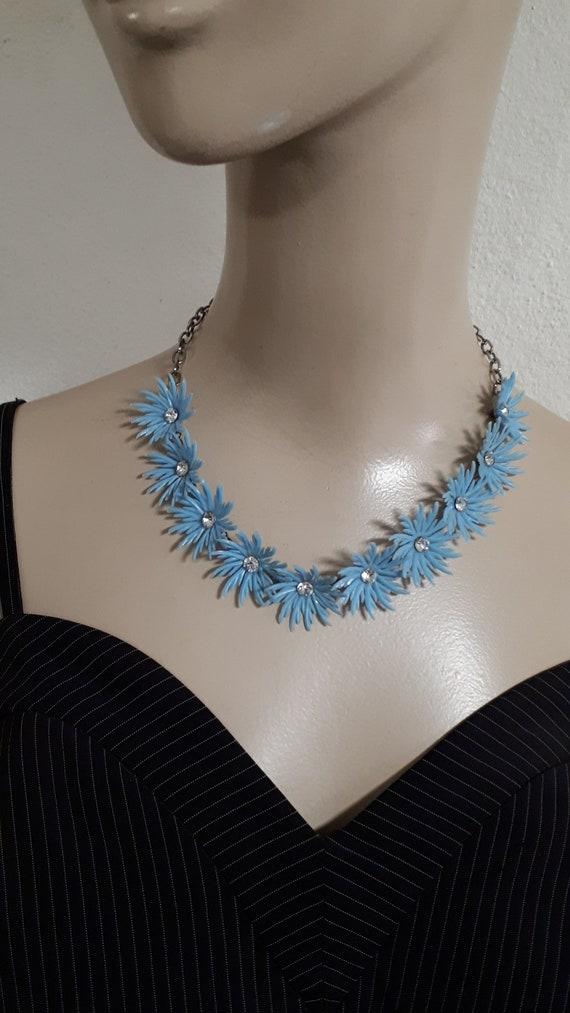 Blue soft plastic feathery floral necklace, RS cen