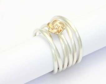 Coiled ring silver with blossom of rose gold