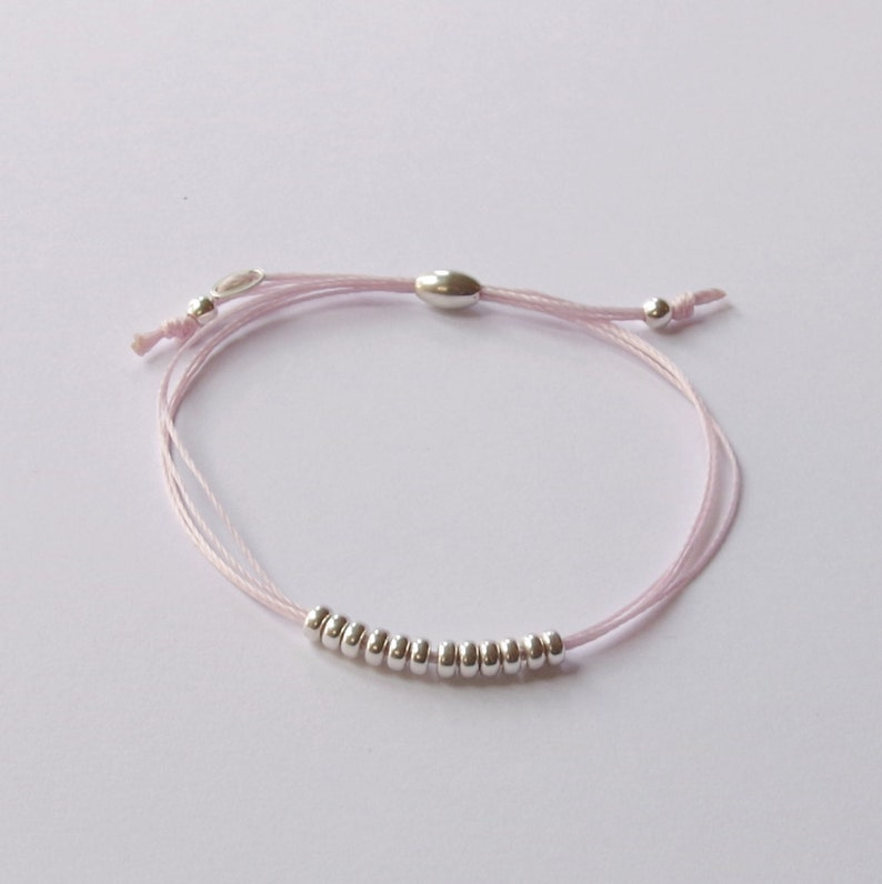 Sterling silver pink silk cord friendship bracelet bead and image 0