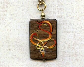 HAND PAINTED PENDANT Jewelry,art,flames,embossed,wood-look bead,16 inch gold metal chain, Swarovski crystal, wearable art, reversible,
