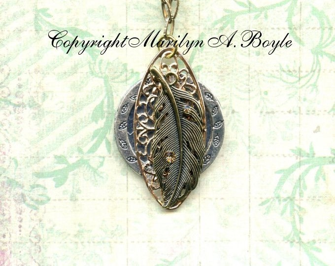HAND MADE PENDANT; jewelry, necklace, wearable art, one of a kind, metals, crystal, feather