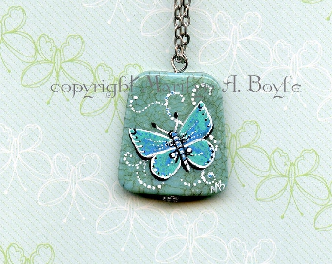 HAND PAINTED STONE; Butterfly, sea blue color, wearable art, pendant, 20 inch chain, nature, magnetic clasp