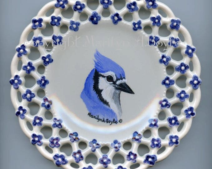 HAND PAINTED PLATE; ceramic, blue flower edging, bluejay inside, 7 inches, black wood stand, shelf art, backyard bird, nature