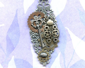 HAND MADE STEAMPUNK; pendant, jewelry, large washer, ornate filigree oval, gears, key,tiny silver ladybug, and a large gear beetle bug.