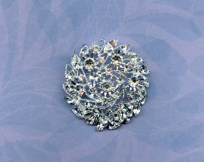 VINTAGE RHINESTONE BROACH; 20% off, large circular pin,excellent condition, 50's ,60's, 2 inches in diameter,many rhinestones in two shapes.