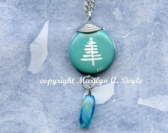 HAND PAINTED PENDANT,stylize tree, blue bead, blue bead hanging under, wearable art, jewely, 18 inch silver metal chain