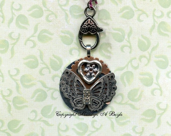 HAND MADE PENDANT; Steampunk, wearable art, necklace, assorted metals, butterfly, heard, small washer, large ornate metal lobster claw