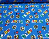Licensed Flannel Fabric - Rubik's Patches on Blue - By the yard - 100% Cotton Flannel