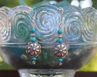 Drop earrings with silver medallion and turquoise beads.  Fun and hip!