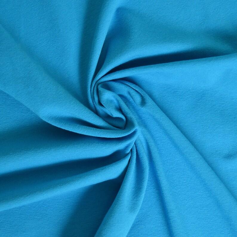 95eddf67375 Turquoise plain cotton-elastane jersey fabric | Etsy