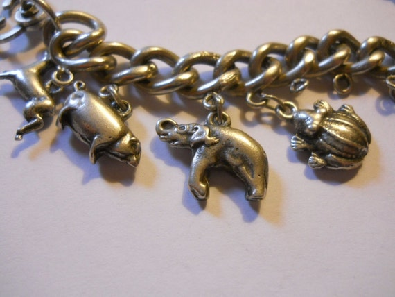 Silver Charm Bracelet 0.900  Vintage Heavy and Solid old world traveler charm bracelet elephant more charms Kewpie Unusual Clasp frog