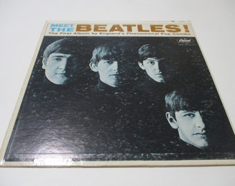 The 1964 Meet the Beatles Original Shirt Tag wUnpunched Wallet Size Photo Beatles