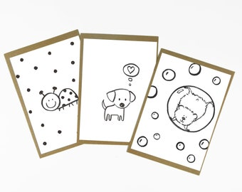 Set of 3 black and white postcards with kraft envelopes. These postcards are made of the drawings I made for the 100 days of pets project