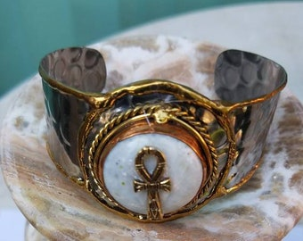 Moonstone w/Ankh charm on a cuff bracelet.