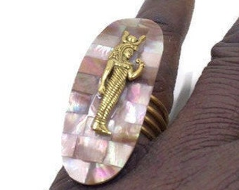 Egyptian Isis symbol on Mother of Pearl Backdrop
