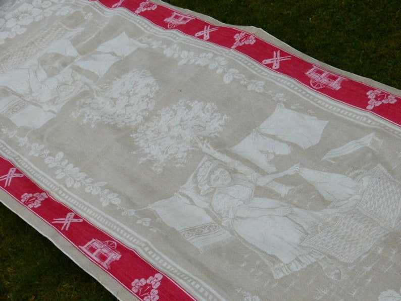 Antik rare picture linen cloth linen cloth with motif Woman hanging up while washing red jewelry border ideal as a tablecloth !