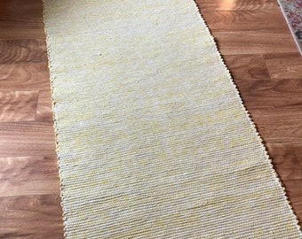 handwoven yellow cotton rug