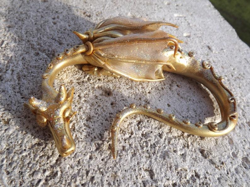 Little sleepy gold dragon image 0