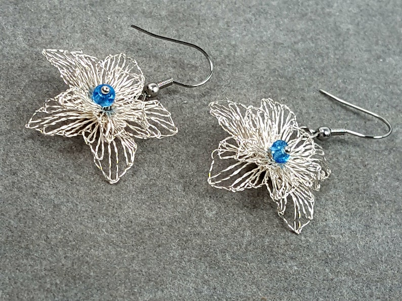 filigree earrings with some blue bobbin lace jewelry image 0