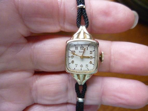 gold tone elgin watch, mechanical swiss watch, gol