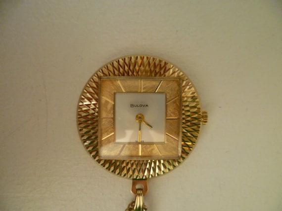bulova pendant watch, gold tone bulova watch