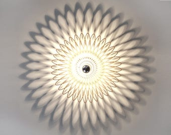 Walllamp , ceiling lamp, spiral ornament, shadow