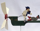 A whirligig with two baseball players. One tries to tag the other out as the blade turns. (Offers Considered)