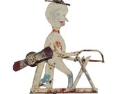 Very folky metal whirligig made from found objects. Weathered paint, mainly white, red with black yellow highlights. (Offers Considered)