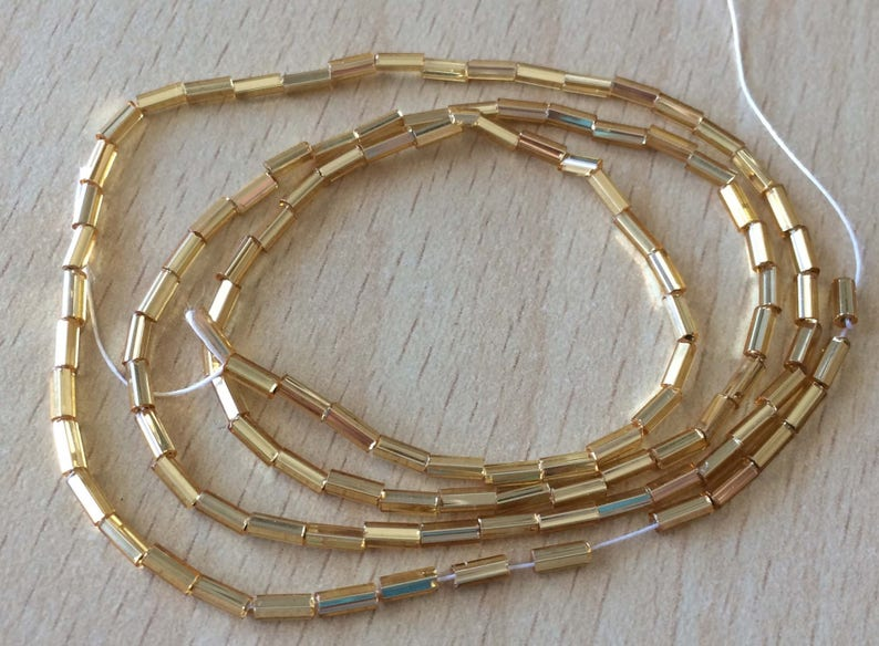 Shiny Gold tubes strung small amount image 0