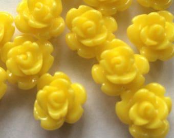 small rose / yellow resin rose