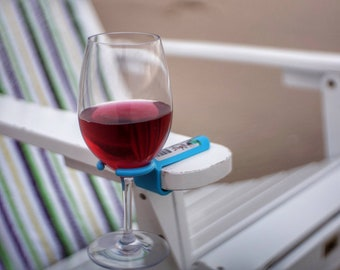 Wine glass holder for an outdoor chair. Works on most Patio, Beach, Camp/Bag chairs! Great Christmas gift!  Makes YOUR chair a better chair!