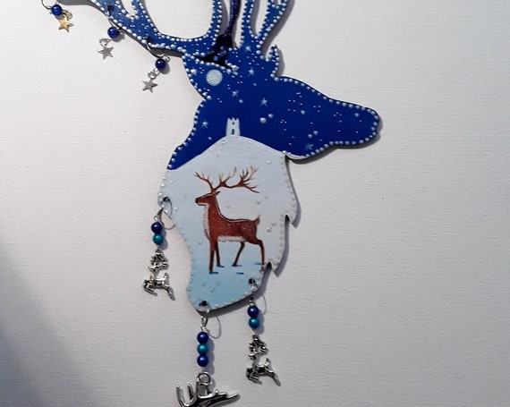 hand painted hanging wooden stag and tor decoration with beads and charms