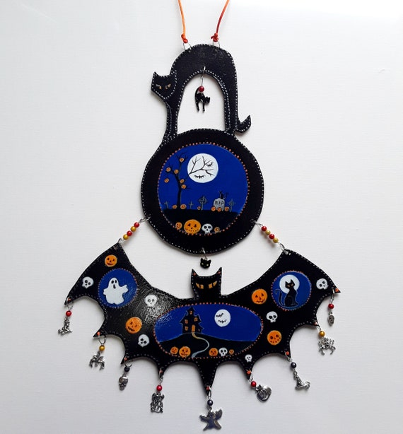 Large hand cut and painted wooden Halloween decoration with added charms and beads