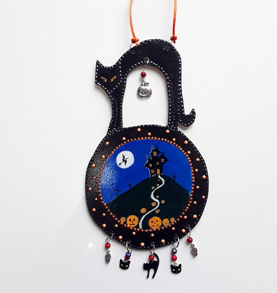 Hand cut and hand painted hanging wooden Halloween decoration with beads and charms.
