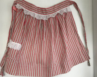 Vintage Christmas apron, candy cane stripes with eyelet lace edging
