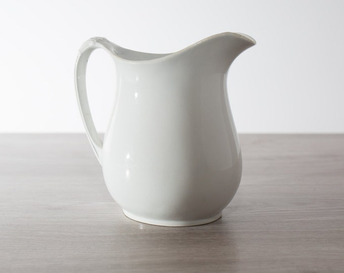 Antique Pitcher / Off-White English Fenton Ironstone Water Jug by W Baker & Co. with a nice leaf thumb rest and dates c. late 1800's