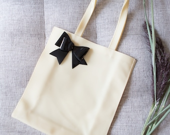 Vinyl Purse with Black Bow - Cream Coloured Faux Latex Bag - Stylish Alice in Wonderland Design Reusable Washable Eco Bag Purse