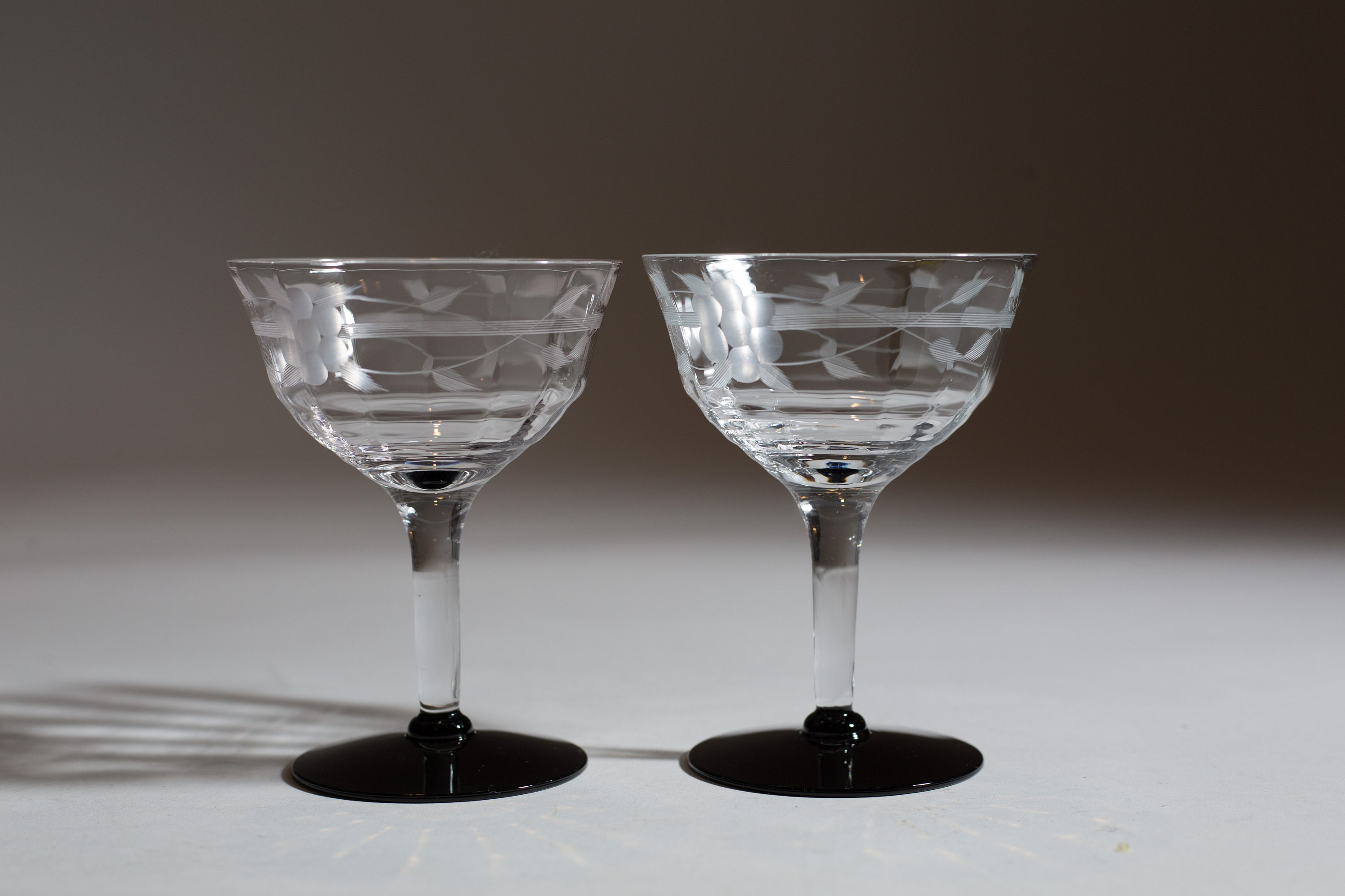 2 Vintage Champagne Coupe Glasses With Black Bases Etched Pattern Glasses Mid Century Modern Cocktail Glasses With Ornate Pattern