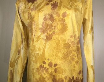 Solid gold, brown flowers all over shirt, long sleeves, unique, beautiful ,comfortable, great for leisure activities , evening out. Anytime.