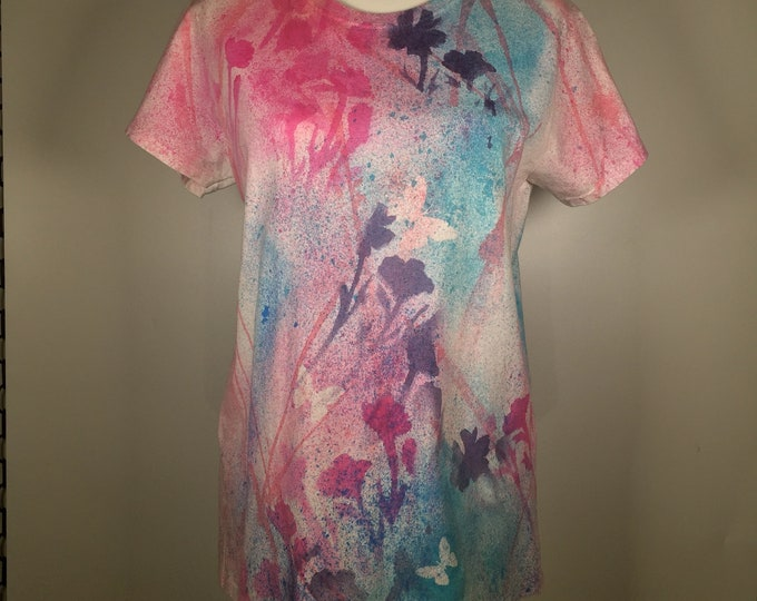 pink turquoise lavender flowers and butterflies all over.  great for outdoor activities and casual activities.