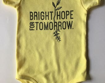 Bright Hope for Tomorrow, size 6-12 Months, Screen printed Baby one piece/romper, yellow with Black print