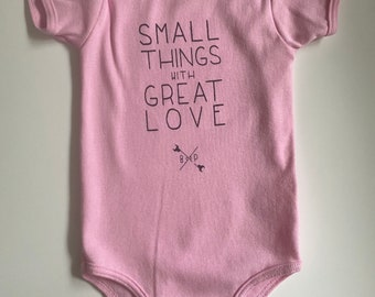 Small Things with Great Love, size 6-12 months, Baby One piece/romper - Soft Pink with Black print, American Apparel