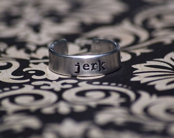 "Jerk - Supernatural Inspired 1/4"" Aluminum Adjustable Ring - Hand Stamped"