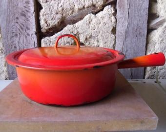 French enamel casserole dish. Enamelware rustic French kitchen. Orange enamel cookware French cooking saucepan casserole pot.